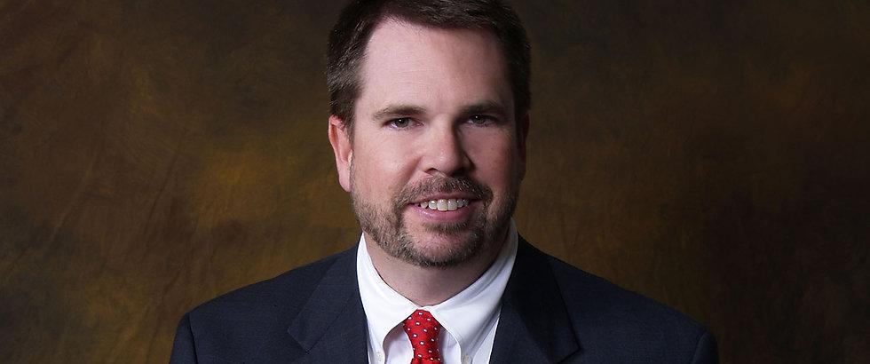 JCG Lawyer Portrait (Smiling).jpg