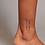 Thumbnail: ANTI TIME tattoo