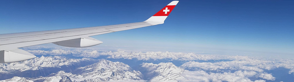 Airplane flying over the Swiss Alps | Switzerland travel