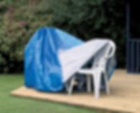 Tarp_covering_garden_furniture.jpg