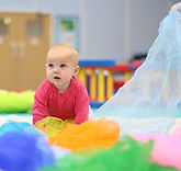 Gymnastics factory babies exploring