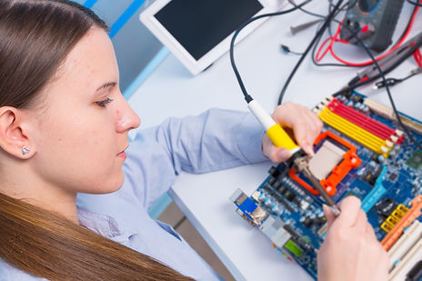Young woman fix PC component in service