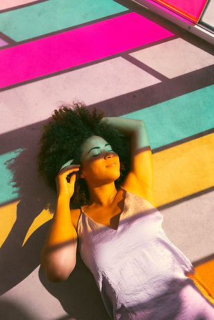 women-lying-near-to-a-multicolored-glass