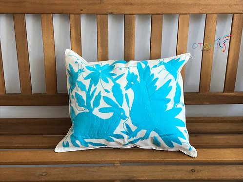 embroidered pillowcases otomi in sky blue on a wooden bench