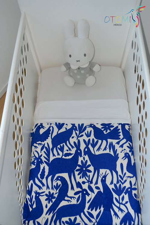 Embroidered baby blanket in cobalt blue with animal designs