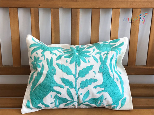 mexican pillow cover in turquoise with an animal design