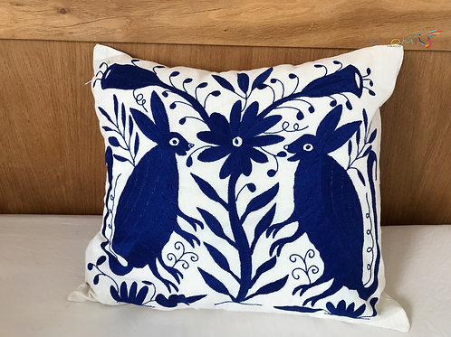 Otomi pillow with a rabbits design in blue hand embroidered in otomi fabric