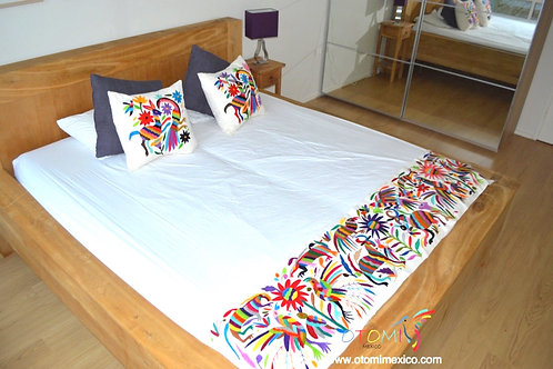 Mexican embroidered bed runner and otomi pillows with animal design in multicolor