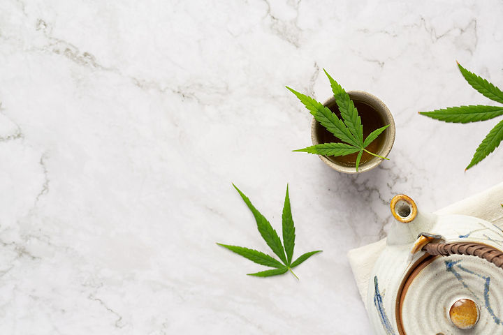 cup-hemp-tea-with-hemp-leaves-put-white-