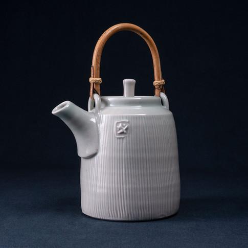 Cane handled Porcelain Tea Pot