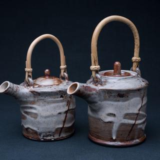 Cane handled teapots