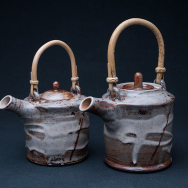 Cane handled teapots