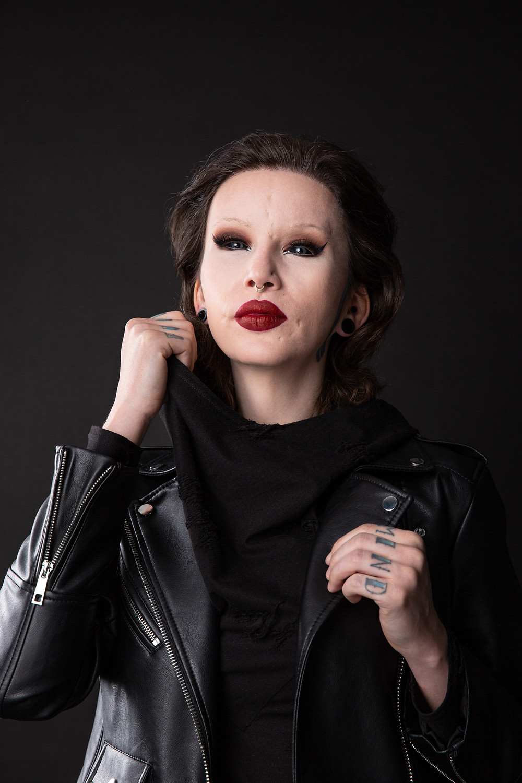portrait photographer alternative model alt tattoo red lipstic black vegan leather body modification bodymod art dark art album cover