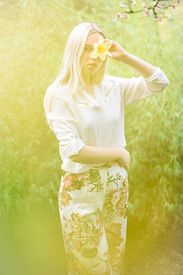 fashion nature wildlife photography portrait Woman holding daffodil in garden