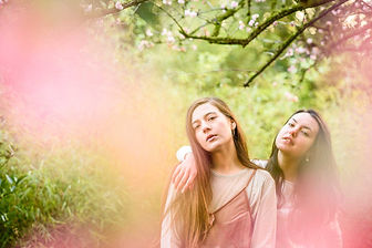 fashion nature wildlife photography portrait Two girls surrounded by blossoms