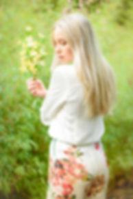 fashion nature wildlife photography portrait Woman holding plum blossoms