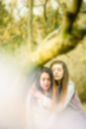 fashion nature wildlife photography portrait Two girls sitting on a tree