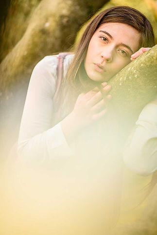 fashion nature wildlife photography portrait flower Girl reclining on a tree branch in spring