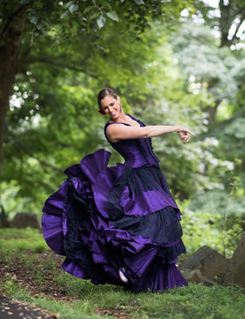 Anna de la Paz is a Spanish dance artist specializing in classical and folkloric Spanish dances.