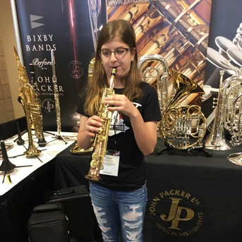 Playing the smallest saxophone at the NAMM show