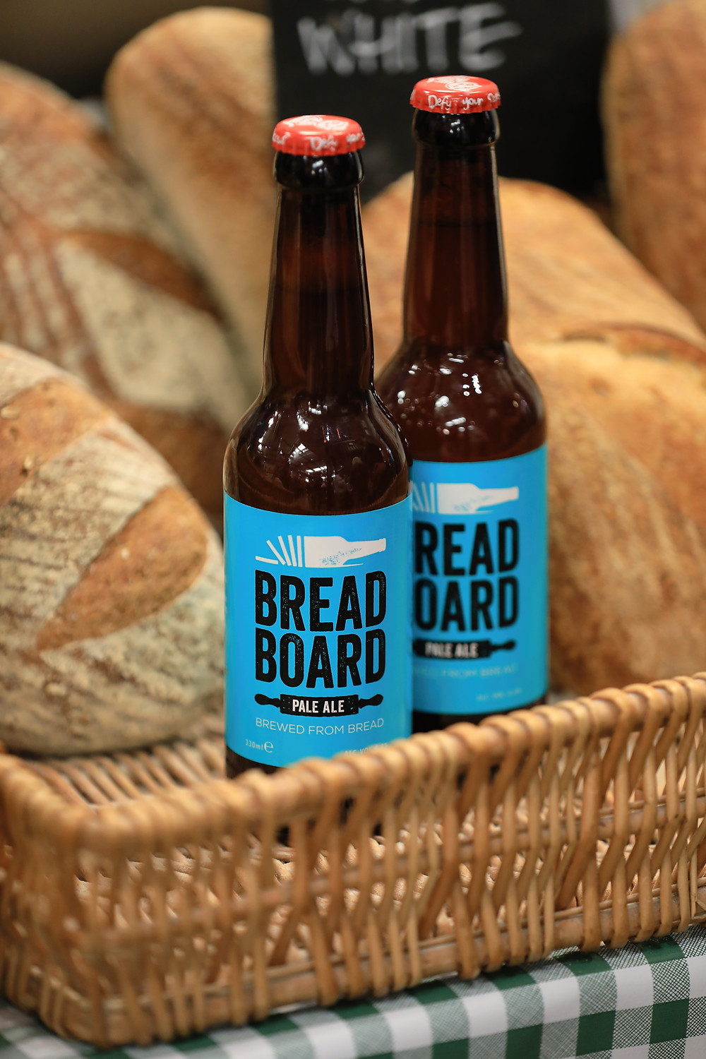Craft beer bottle, bread, food waste
