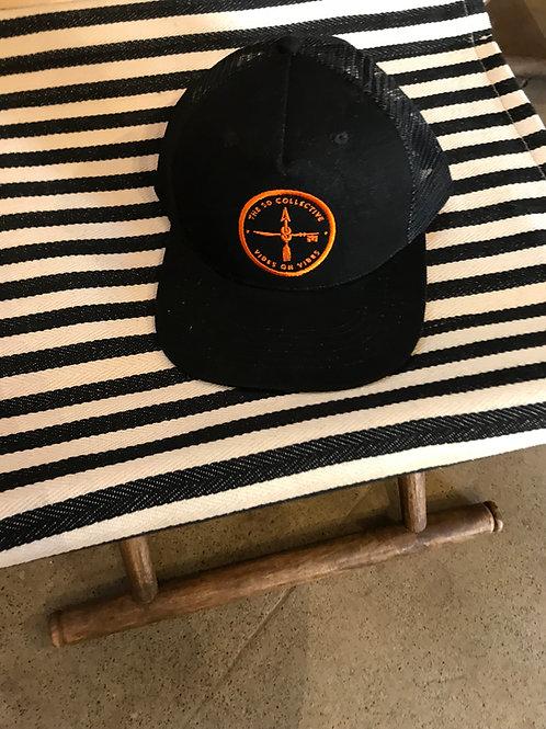 The SDC Orange Logo on Black Mesh Trucker Hat