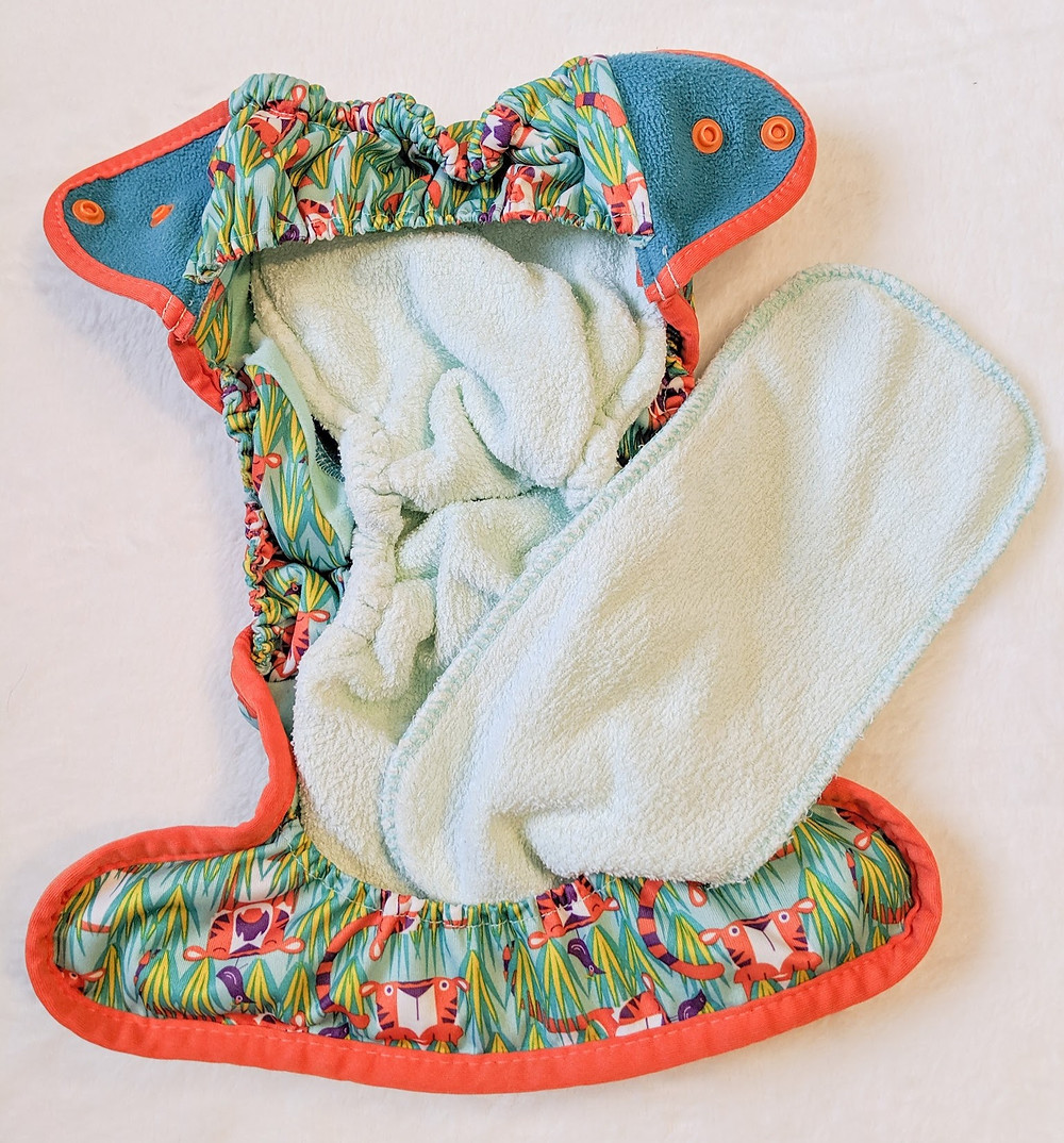 Inside of a Close Pop-In Nappy showing the booster and soaker shape