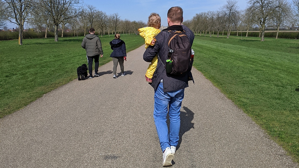 Dad and his Toddler walking down the Long Mile in Windsor
