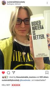 Marina McCoy, Sustainabilitybosslady, of Waste Free Earth holding a bottle of Boxed Water