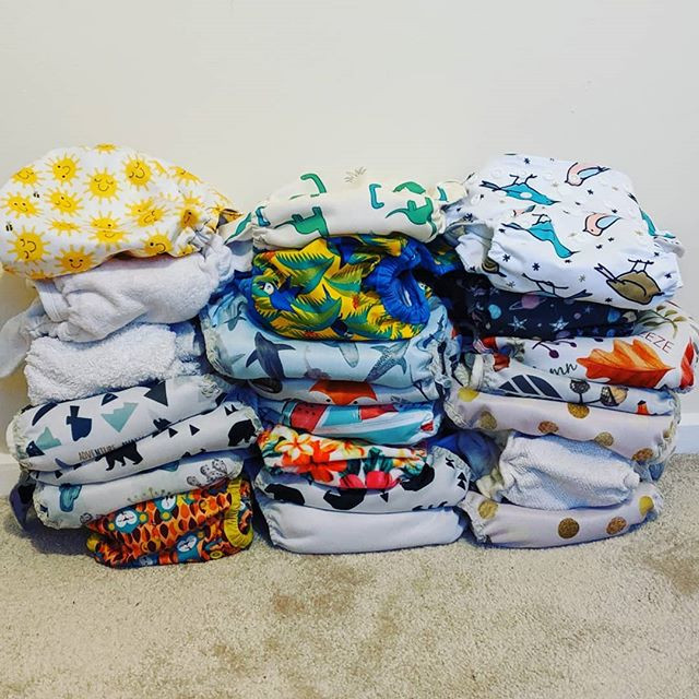 Colourful stack of modern cloth nappies
