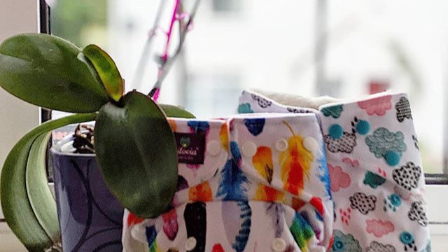 Modern cloth pocket nappies on windowsill
