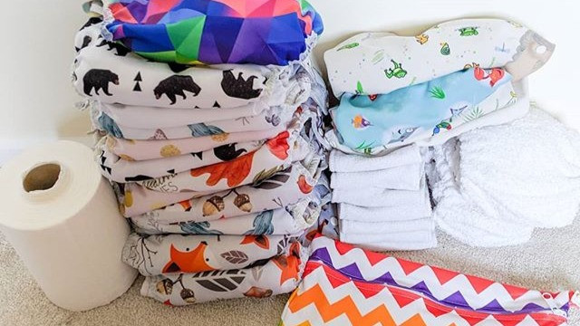 Modern cloth nappies, disposable liners, cotton boosters fitted night nappies, nappy wraps and a wet bag