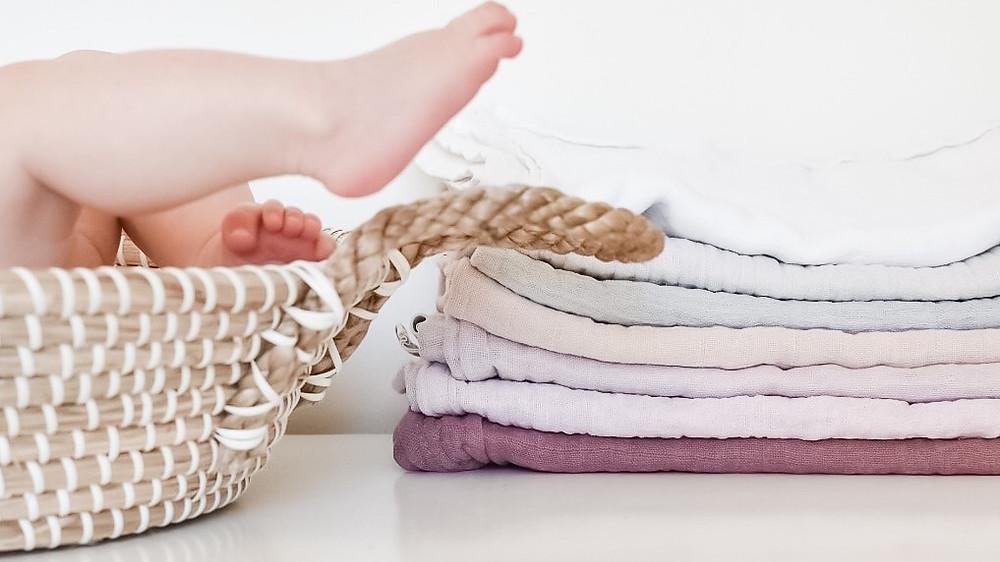 stack of muslin cloth nappies