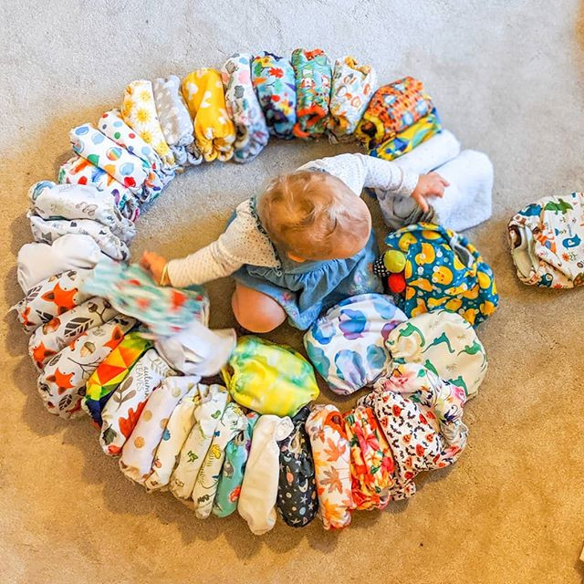 Baby girl destroying cloth nappy circle stash shot