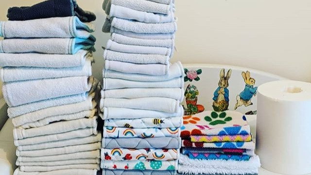Stacks of reusable nappy boosters and liners for nighttime use