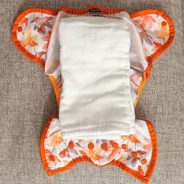 Pre-fold reusable nappy in a Thirsties nappy wrap