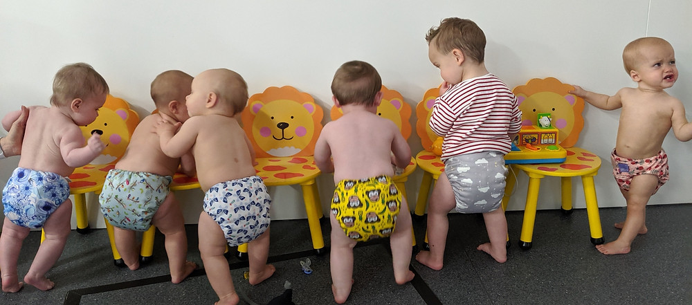 Six babies in reusable nappies at a play cafe