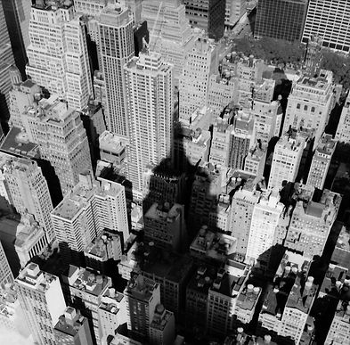 Empire State Building Shadow over Mid-Town New York City, NY, USA