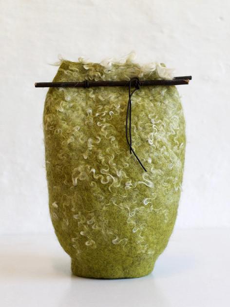 Såne med grøn uld