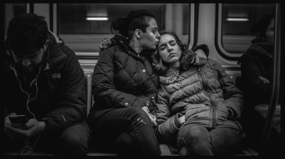 Couple in CTA train— Chicago, 2016