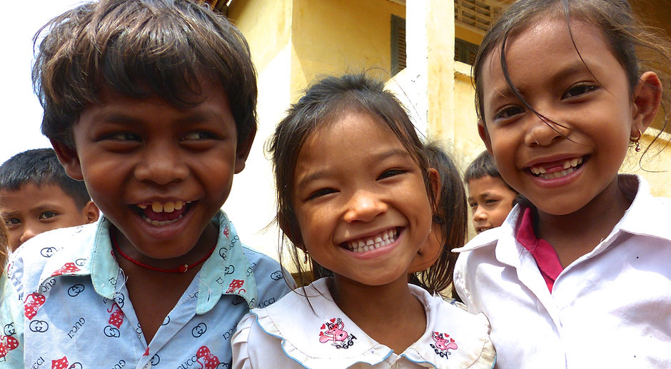 Three Smiling Children at Prey Veng Province