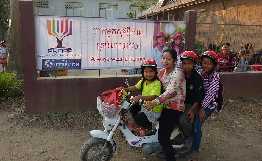 Three children from Sovann Komar School leave safely with new helmets