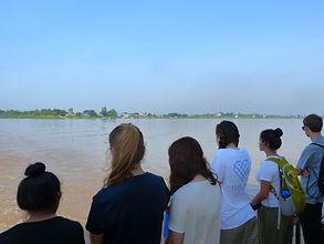 Volunteers from Millbrook School travel across the River Mekong