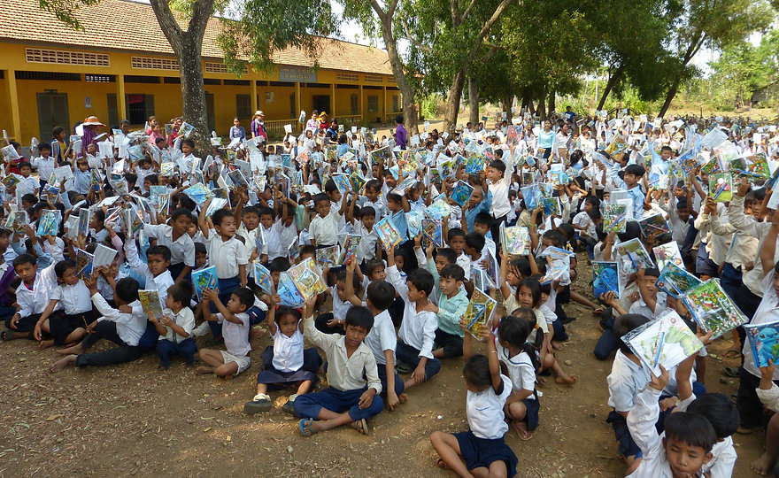 Handing out stationary in Kampong Thom