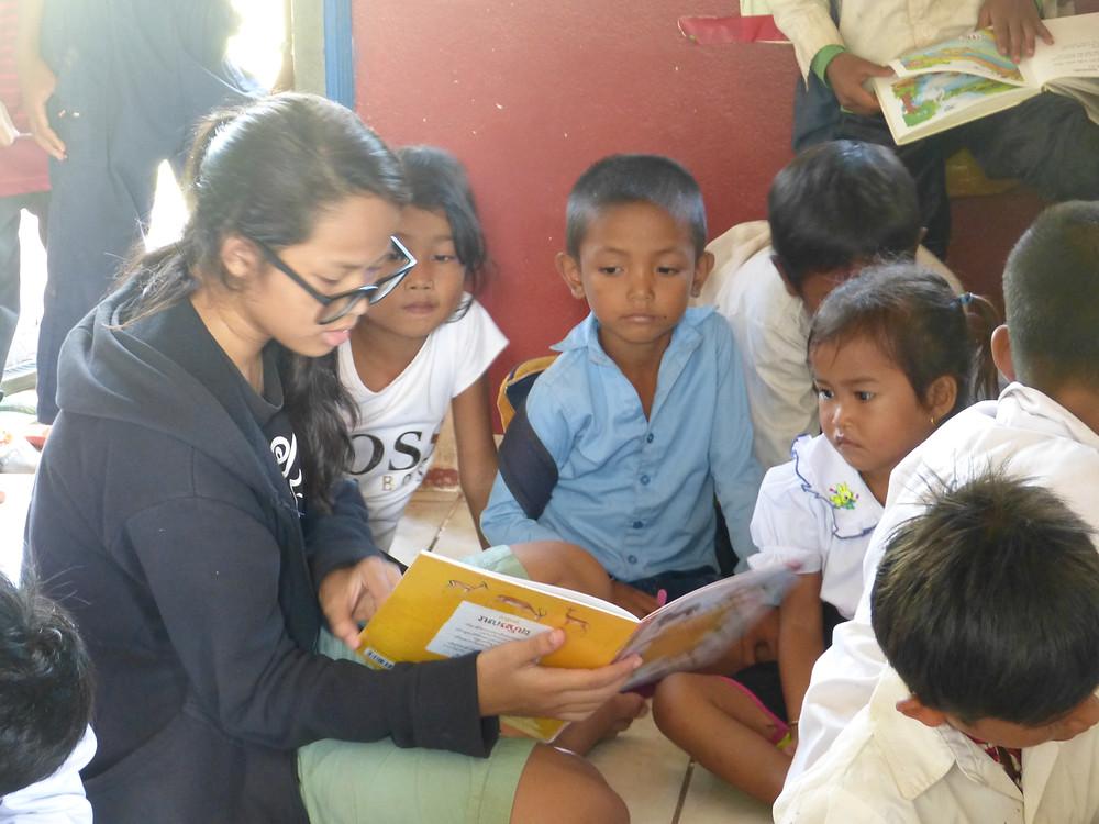 Rachana reads to three small children