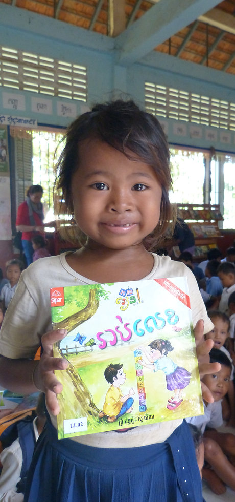 Donating library books to a school in Cambodia