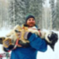 Man holding sled dog