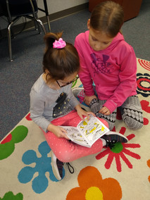 Elementary_girls_with_books_2