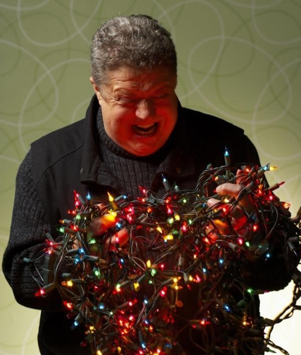 Man with tangled Christmas lights