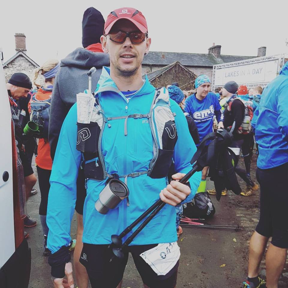 Runner ready for Lakes in a day race 2017 equipped with poles and running hat